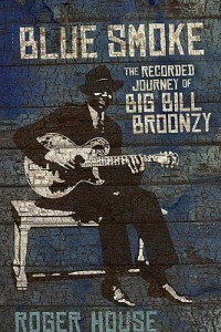 a stylized black portrait of blues artist Big Bill Broonzy is shown on a crackle finish distressed blue plank background