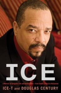 American rapper / actor Ice-T is in a dark suit with a deep red shirt, and dark tie