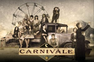 The cast of HBO's show Carnivale sit in costume, dust bowl era fashions and a pickup truck framing a ferris wheel