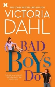 On an orange cover, the characters sit atop large blue letters - a white girl in office attire is posed atop the B in boys, a casually dressed white male leans in the lower corner agains the o in do.