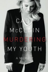 A blonde white woman in casual modern clothing looks downward, the cover is in black and white with the word murdering in red