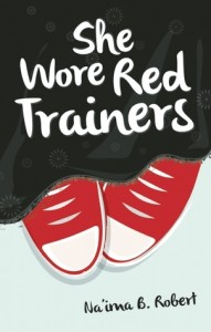 Red Converse peek out from a long black skirt, the book title scrawled in white above