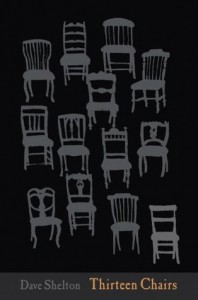 Grey dining chars of various design are arranged in a jumbled grid on a black background