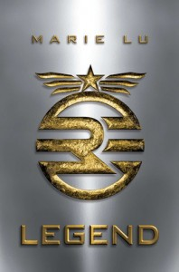 On a silver metallic background a raised emblem in gold, military in nature but not recognizable.