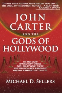 Red and gold dominate a cover with white lettering across the center, a red and gilded mars at the top, golden ropes down the sides to mark off a central red carpet