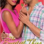 a black man and woman embrace on a pink and pastel cover, she looks toward the viewer, he looks only at her